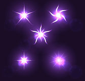 Set forms of sparks. Shining star on a dark backgr Royalty Free Stock Photography