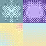 Set of four abstract backgrounds with dotted halftone effect. Set of four abstract pastel colored backgrounds with dotted halftone effect. Vector illustrationn Stock Photo