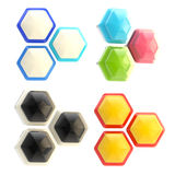 Set of four abstract emblems made of hexagons Stock Photos