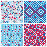Set of four abstract geometric backgrounds. In red, blue, white colors. Vector seamless patterns Royalty Free Stock Photo