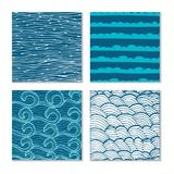 Set of four abstract hand-drawn wave patterns. Stock Images