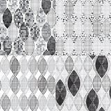 Set of four abstract monochrome geometric patterns. Stock Images