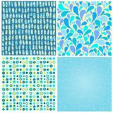 Set four abstract seamless backgrounds of blue color Royalty Free Stock Images