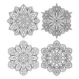Set of four abstract vector round lace designs - mandalas, decor Royalty Free Stock Photo