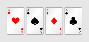 Set of four aces playing cards suits. Winning poker hand. Set of hearts, spades, clubs and diamonds ace.  Royalty Free Stock Image
