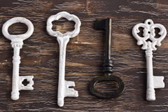 Set of four antique keys, one being different and upside down Royalty Free Stock Image