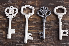 Set of four antique keys, one being different Stock Photography