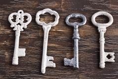 Set of four antique keys, one being different Royalty Free Stock Image