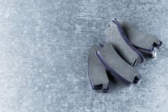 Brake pads on a gray background stock photos