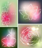 Set of four backgrounds or greeting cards with orchid, lotus and rose in beautiful colors Royalty Free Stock Images