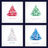 Set of four beautiful christmas cards. With abstract trees Royalty Free Stock Photography