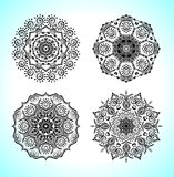 Set with four beautiful Mandalas. Vector ornaments, round decorative elements for your design Royalty Free Stock Photos