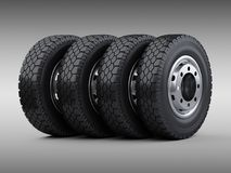 Set of four big vehicle truck tires stacked. New car wheels with Stock Images