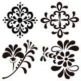 Set of four black flowers Stock Photo