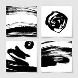 Set of four black ink brushes grunge square pattern Royalty Free Stock Photo