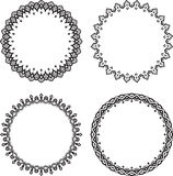 Set of four black round frames on a white background. Royalty Free Stock Photography