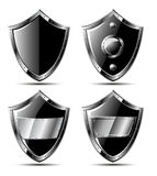 Set of four black steel shields Stock Photo