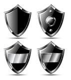Set of four black steel shields royalty free illustration