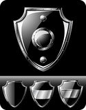 Set of four black steel shields Royalty Free Stock Image