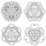 Set of four black and white mandalas. stock photos