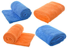 Set (four) of  blue and orange towels isolated on white backgrou Stock Image