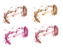 Set of four blushes and face corrector isolated on white. Crushed blushes set in trendy bright colors. Stock Photo