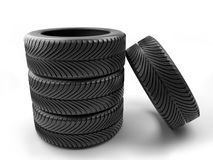 Set of four car tires. Shot on white Stock Photography