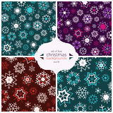 Set of four christmas backgrounds with beautiful snowflakes Stock Images