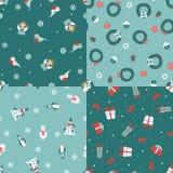 Set of four Christmas seamless patterns Royalty Free Stock Photos