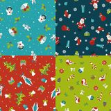 Set of four Christmas seamless patterns Royalty Free Stock Images