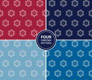 Set of four Christmas seamless patterns Stock Images