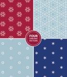 Set of four Christmas seamless patterns Stock Photos