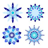 Set of four circle ornaments. Set of four blue vector mandalas. Collection of stylized round ethnic ornaments. Blue design elements. Colorful patterns Stock Photo