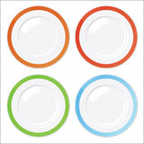 Set of four clean plates with colored borders. Isolated on white background Stock Photo