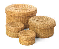 Set of four closed wicker baskets on a white background. Handmade boxes for a picnic or storing old things Royalty Free Stock Image