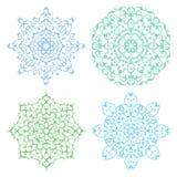 Set of four cold color lacy mandalas Stock Images