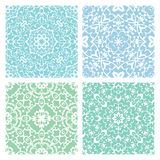 Set of four cold color lacy seamless eastern patterns. Set of four cold color lacy quadrate seamless oriental backgrounds Royalty Free Stock Photo