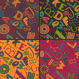 Set of four color variations seamless patterns with hand drawn fancy alphabet Stock Images