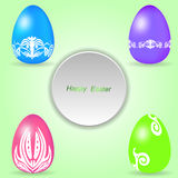 Set of four colored Easter eggs on a light green background with tag. Stock Images