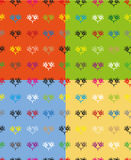 Set of four colored seamless pattern. Seamless pattern with patterns of multicolored hearts on a dark grey background Royalty Free Illustration