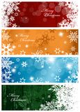 Set of four colorful Christmas background banners. With snowflakes and simple Merry Christmas text - horizontal version Royalty Free Stock Images
