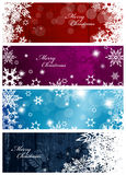 Set of four colorful Christmas background banners. With snowflakes and simple Merry Christmas text - horizontal version Royalty Free Stock Image