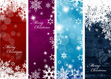 Set of four colorful Christmas background banners. With snowflakes and simple Merry Christmas text - vertical version Royalty Free Stock Photography