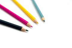 Set of four colorful crayons. On white background, education concept royalty free stock photo
