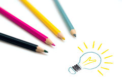 Set of four colorful crayons drawing light bulb. Business creativity and idea concept stock photos