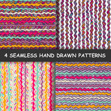 Set of four colorful seamless hand drawn graphic striped patterns. Stock Photo