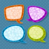 Set of four colorful speech bubbles with leaves on seamless raindrops pattern Stock Photography
