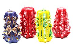 Set of four colorful wax candles handmade carved, on white Royalty Free Stock Image