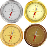 Set of Four Compasses. Using different metals isolated on white Stock Image
