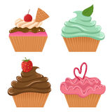 Set of four cupcakes. Set of delicious cupcakes with different cream and berries Royalty Free Stock Images